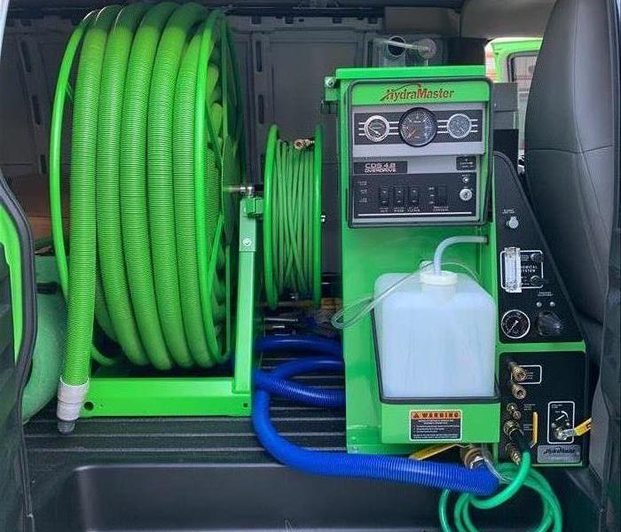 the back of a van with green equipment