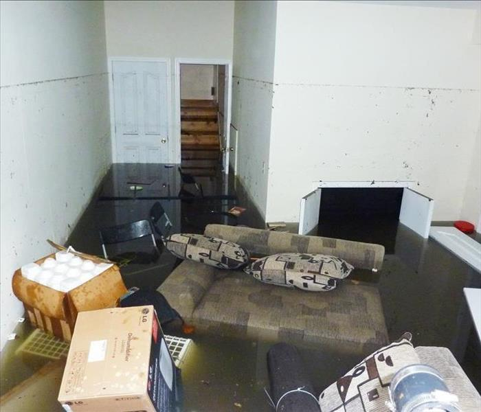 Completely flooded basement with a line showing maximum water level higher than 7 feet.