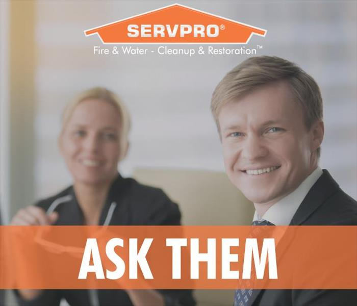 A male and female office worker smiling, Servpro logo and the phrase ASK THEM.